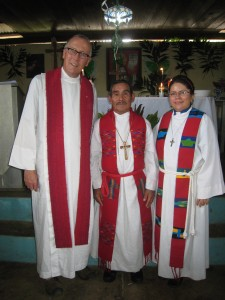 Our new ordained pastor, Fabián between pastors Mark and Karen.